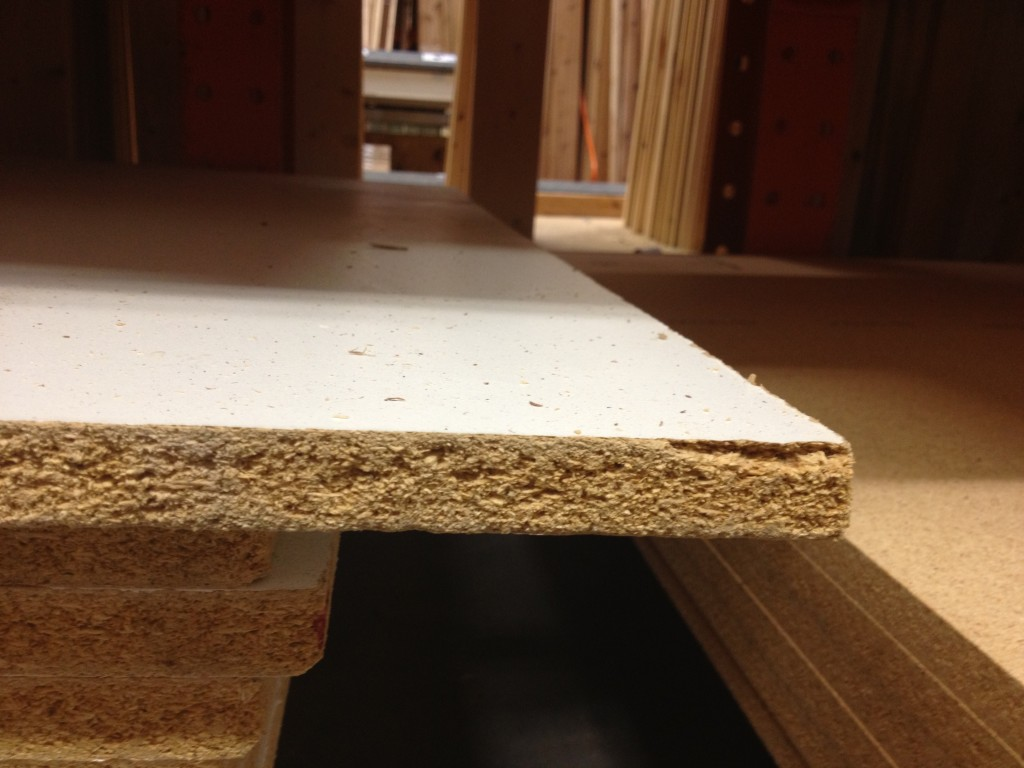 Particle board often used in closet shelving